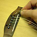 Thay dây đàn guitar