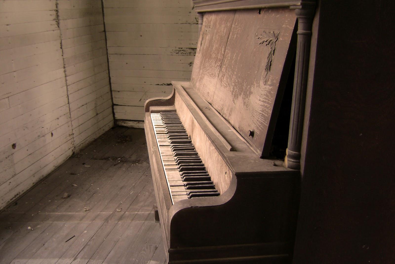 mua dan piano cu va yeu to gia tri